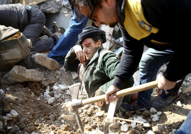 A man gets stuck under debris at a damaged site after an airstrike in the Saqba area, in the eastern Damascus suburb of Ghouta, Syria, January 9.