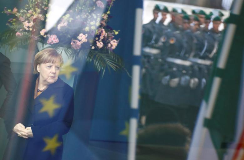 German Chancellor Angela Merkel waits at the chancellery in Berlin, March 20
