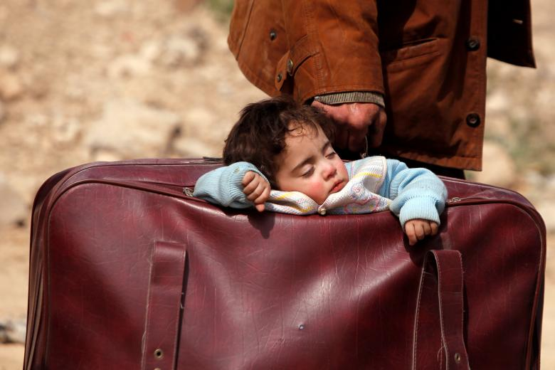 A child sleeps in a bag in the village of Beit Sawa, eastern Ghouta, Syria, March 15. REUTERS/Omar Sanadiki