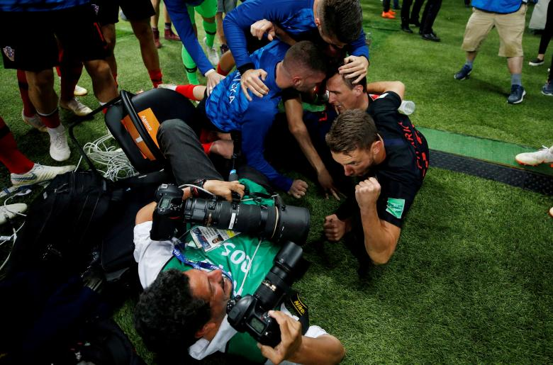 Croatia players celebrate next to an AFP photographer Yuri Cortez after Mario Mandzukic scored their second goal against England during the World Cup semi-final in Moscow.