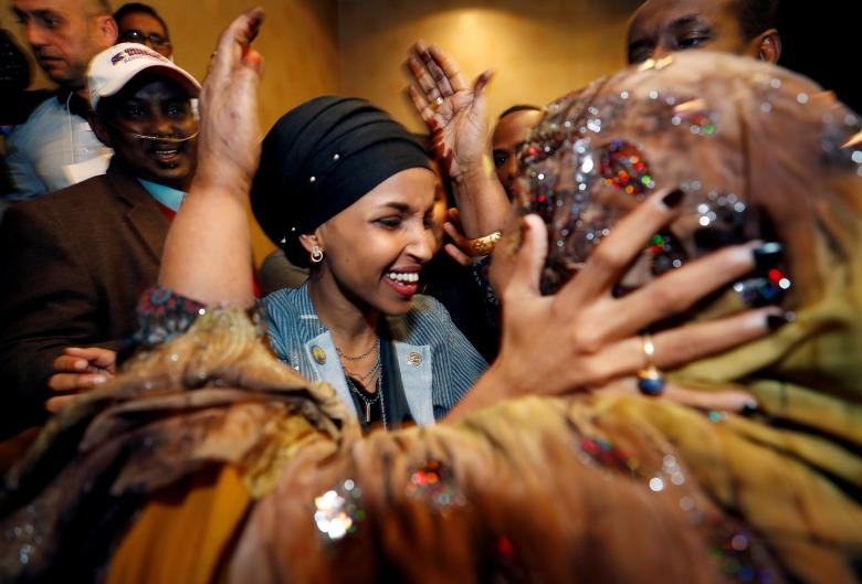 U.S. Democratic congressional candidate Ilhan Omar is greeted by her husband's mother after appearing at her midterm election night party in Minneapolis, Minnesota, November 6.
