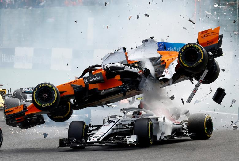 McLaren's Fernando Alonso and Sauber's Charles Leclerc crash at the first corner during the F1 Belgian Grand Prix, August 26.