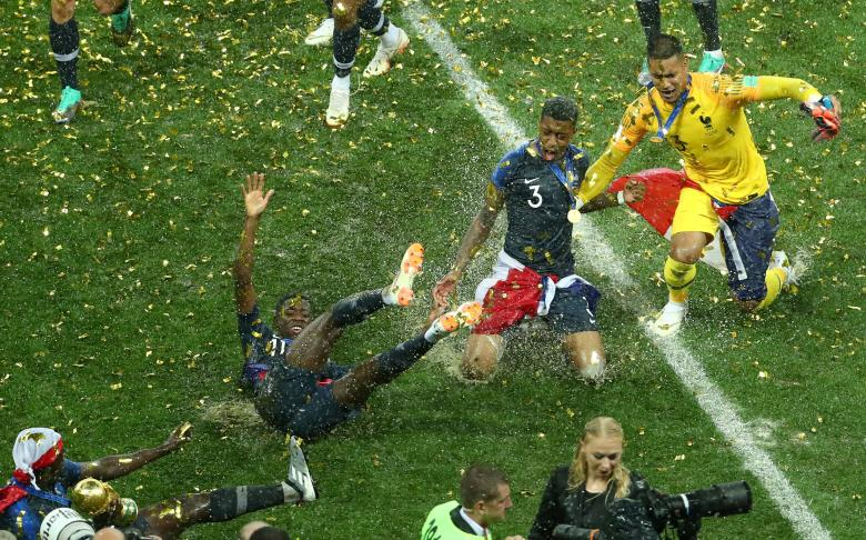 France's Ousmane Dembele, Presnel Kimpembe and Alphonse Areola celebrate defeating Croatia to win the World Cup at Moscow's Luzhniki Stadium, July 15.