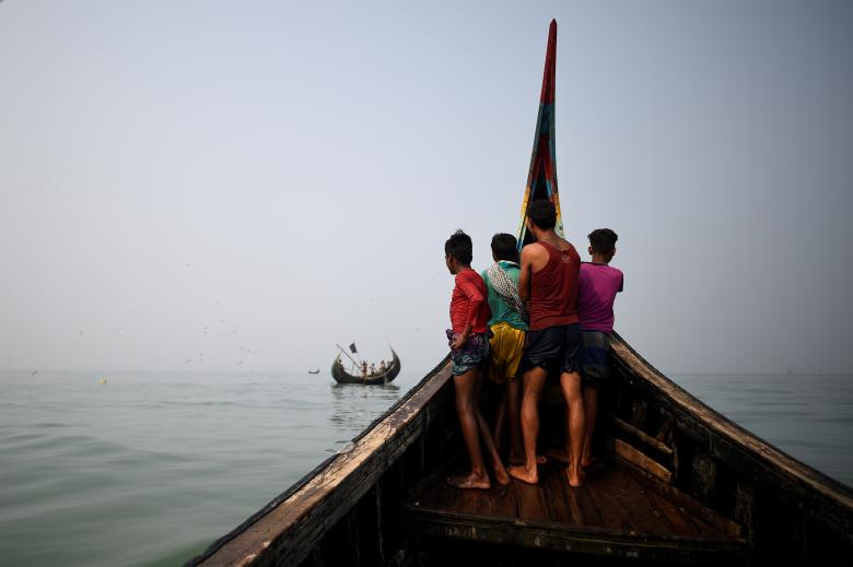 Rohingya refugees crew a fishing boat in the Bay of Bengal near Cox's Bazaar, Bangladesh, March 24.