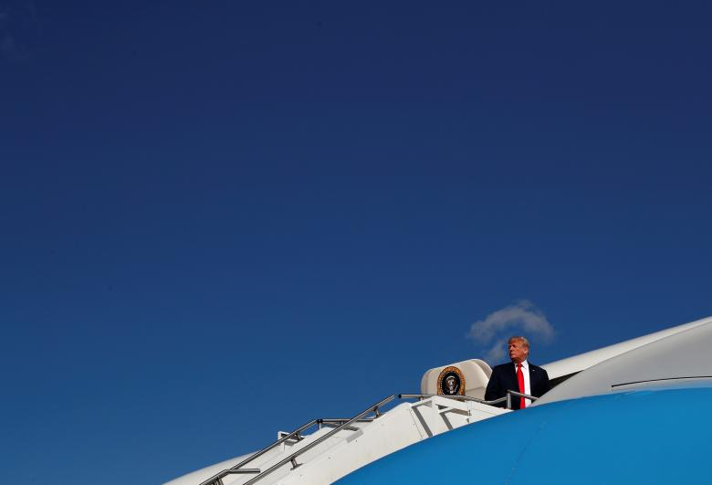 U.S. President Donald Trump boards Air Force One