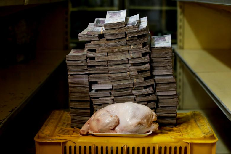 chicken is pictured next to 14,600,000 bolivars,