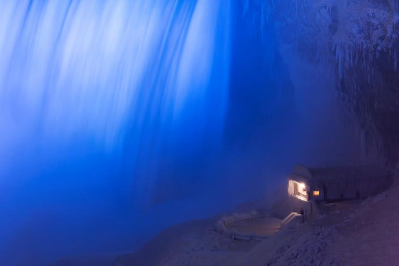 A building covered in ice sits at the base of the Horseshoe Falls in Niagara Falls, Canada, January 2.