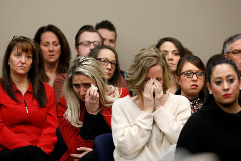 Victims and others look on as Rachael Denhollander speaks at the sentencing hearing for Larry Nassar, a former team USA Gymnastics doctor who pleaded guilty in November 2017 to sexual assault charges, in Lansing, Michigan, January 24.