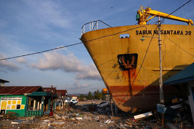 A ship is seen stranded on shore after an earthquake and tsunami hit the area in Wani, Donggala, Central Sulawesi, Indonesia, October 3.