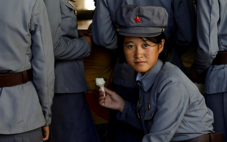 A soldier eats ice cream as she visits a zoo in Pyongyang, North Korea, September 12.